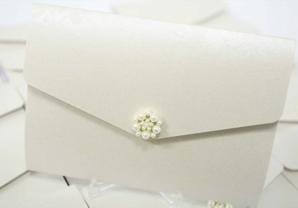 ivory pocketfold A6 invite with large pearl cluster