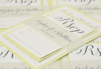 lemon letter stack with band invite