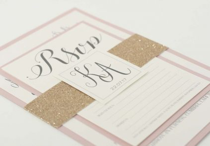 rose gold letter stack with glitter band invite