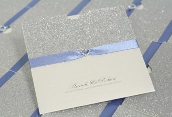 silver glitter, sky blue ribbon and diamante heart wallet invite