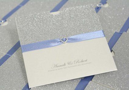 silver glitter, sky blue ribbon and diamante heart wallet invite