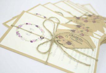 vintage letter stack, purple flower wreath with monogram invite