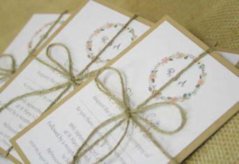 vintage letter stack with monogram flower wreath invite