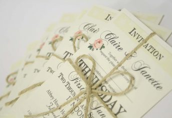 vintage rose letter stack invite