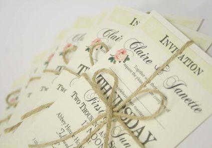vintage rose letter stack invite